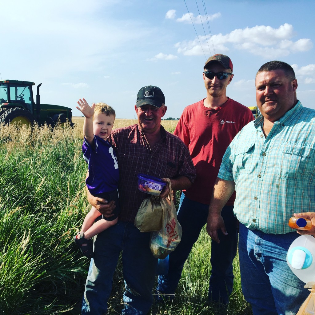 Derek, his father, our hired man and oldest son, Evan, stop for a picture before heading back to the fields to enjoy supper and continue cutting.